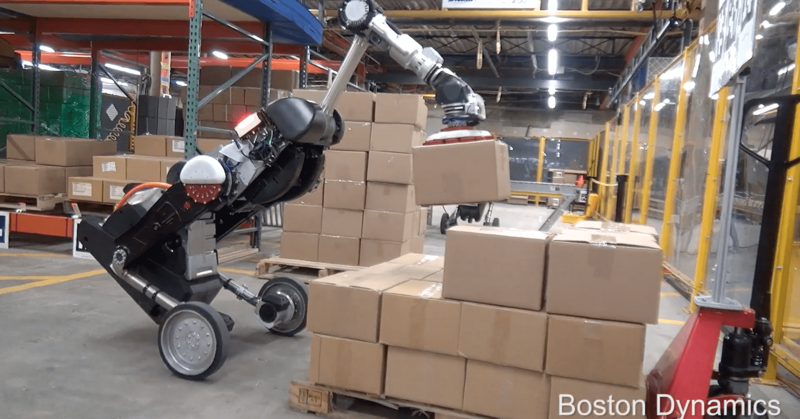 Watch this gigantic bird-like robot load boxes onto a