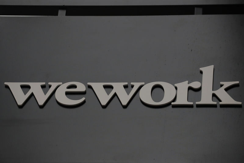 © Reuters. FILE PHOTO: The WeWork logo is displayed outside of a co-working space in New York