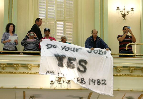 "Demonstrators waved a banner in the State Assembly chamber calling for approval of a bill capping rent increases. ""Passing tenant legislation in Sacramento is incredibly difficult,"" the bill's sponsor said."