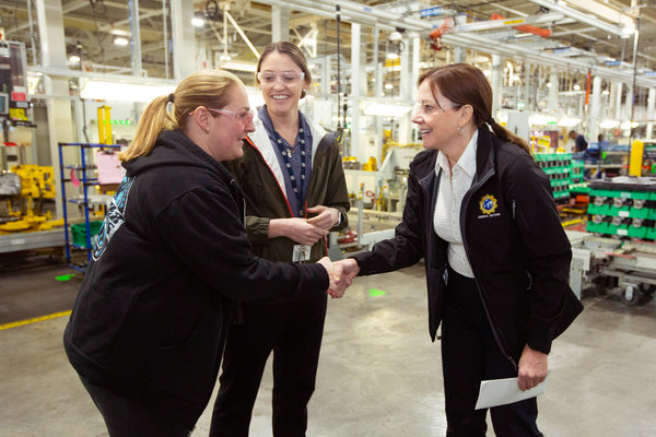 Ms. Barra in February with employees at a transmission plant in Romulus, Mich., where the company plans a new investment. She has often spoken of her experience on G.M.'s factory floor.