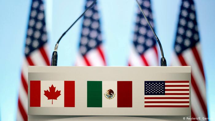 US, Canadian and Mexican flags (Reuters/E. Garrido)