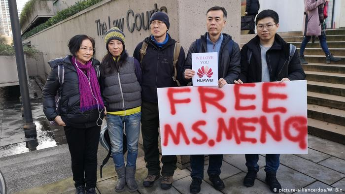 People protest Mengs arrest outside the Vancouver Supreme court