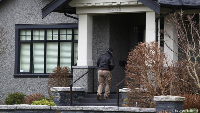 Meng Wanzhou's family mansion in Vancouver, with a security guard outside