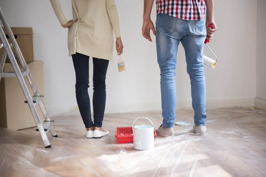 couple painting home improvement project